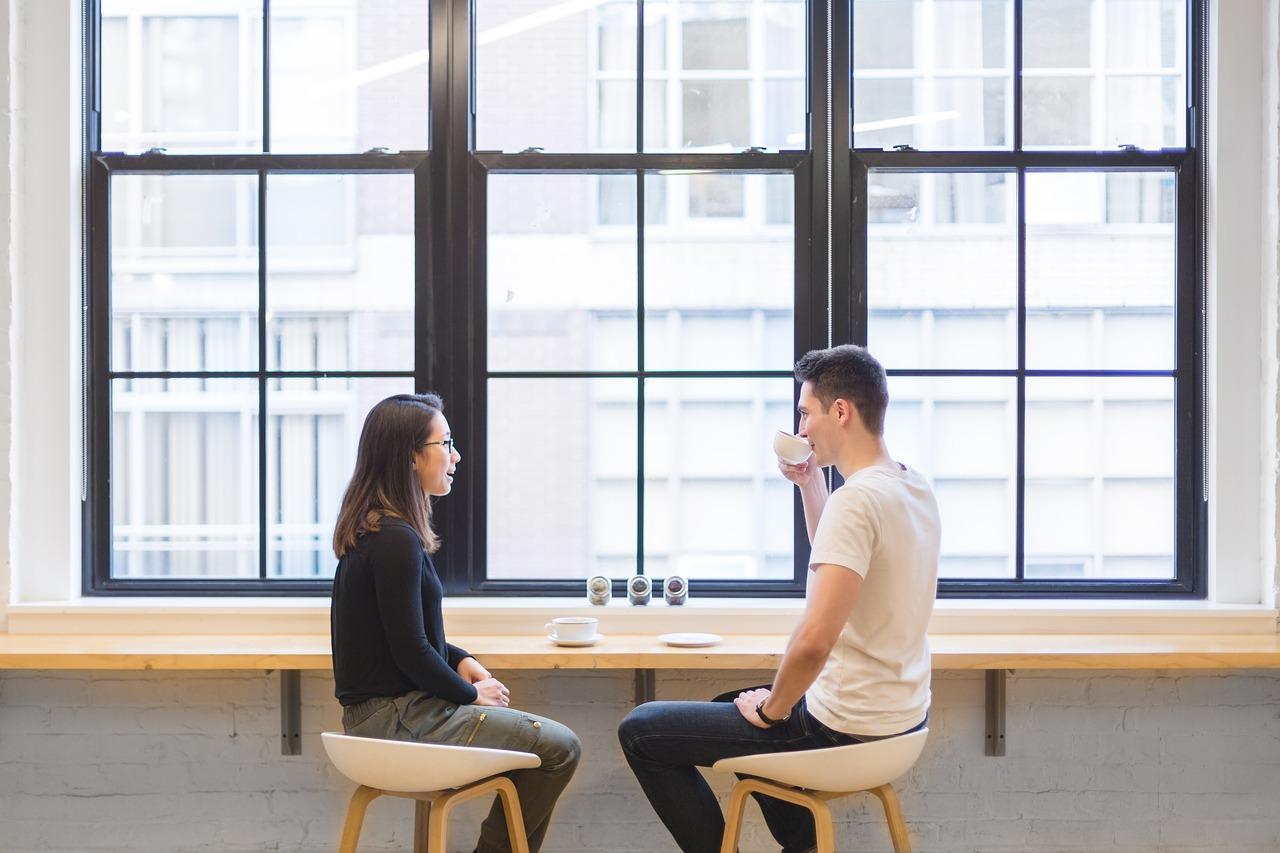 couple-talking-cafe